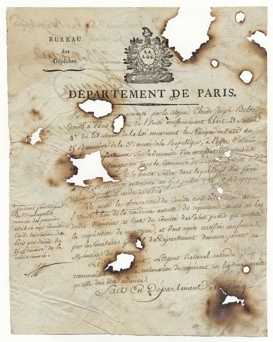 Document calciné lors de l'incendie de l'hôtel de Ville le 24 mai 1871.