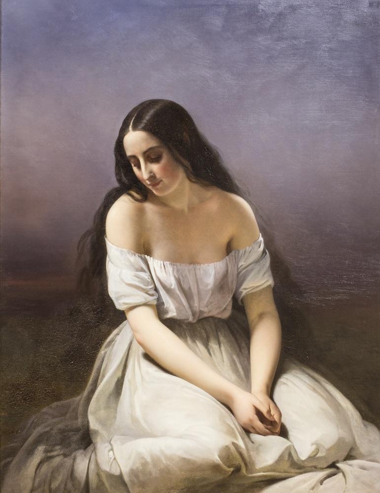 Une jeune fille à genoux