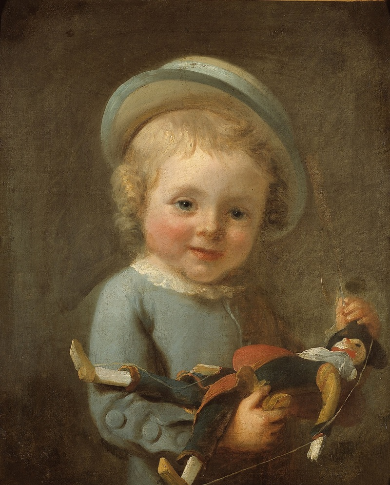 Portrait de garçonnet tenant un polichinelle