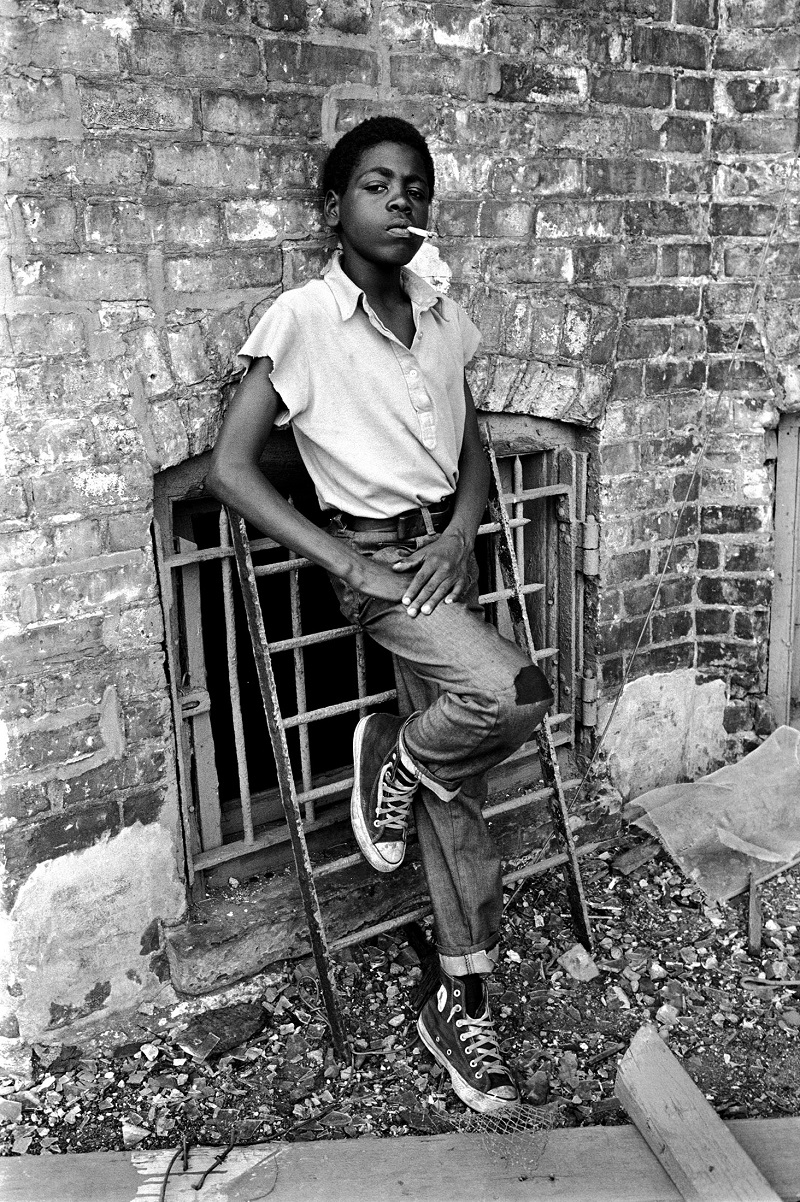 Chicago, Illinois, USA: African-American boy smokes a cigarette on the south side, 1972