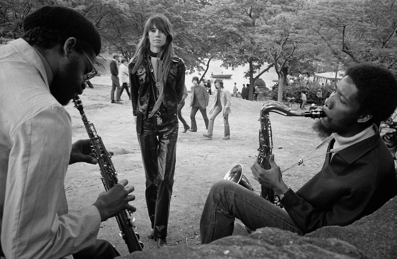 May 1969, Manhattan, New York City, USA. French singer Francoise Hardy listens to a saxophonist and a clarinet player in Central Park.