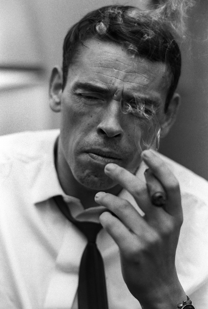December 4th, 1965. New York City. Jacques Brel in his hotel room smoking a cigar.