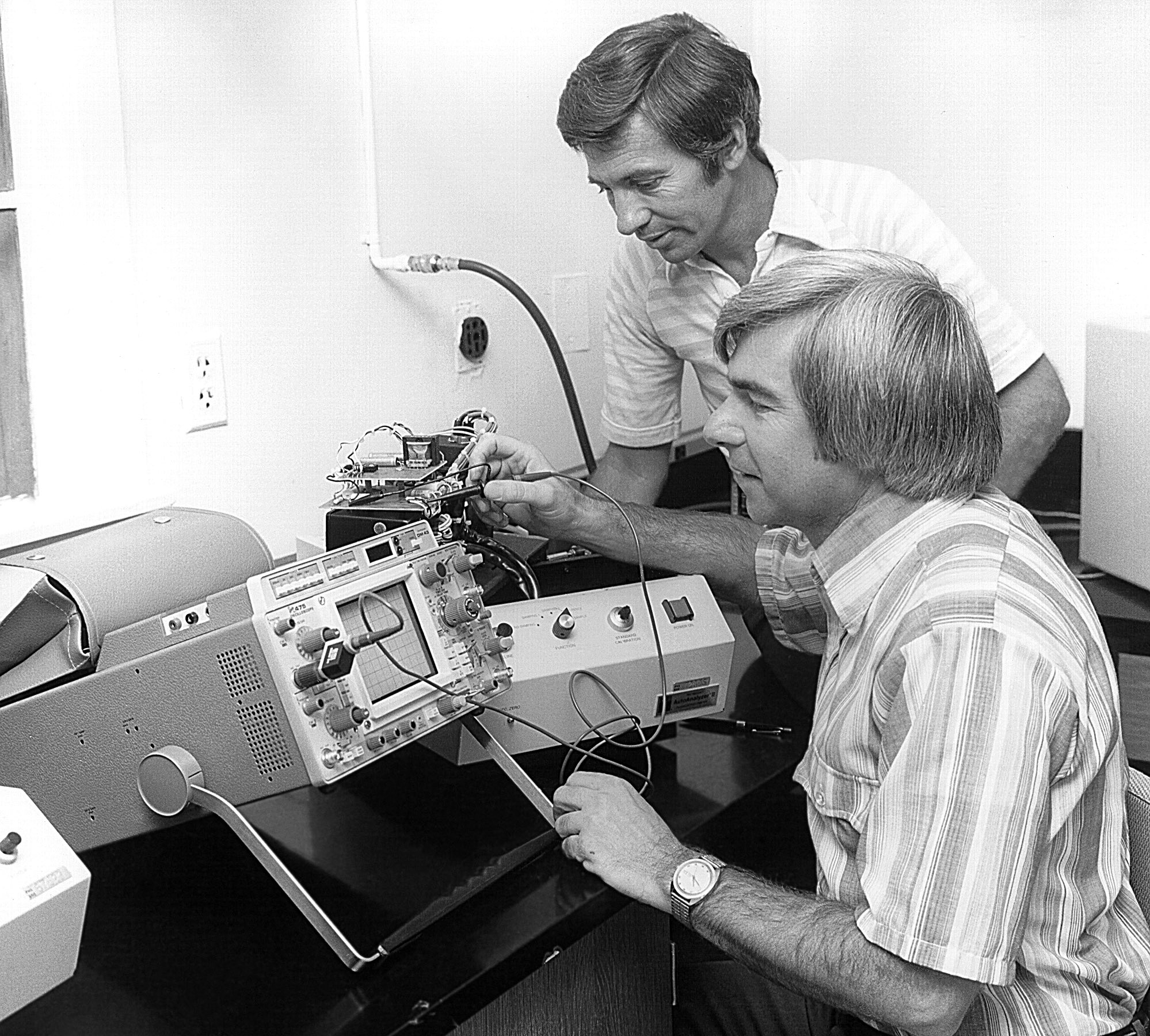 This historic image, depicted these two Centers for Disease Control and Prevention (CDC) laboratory technicians, who were at work in a CDC laboratory.
