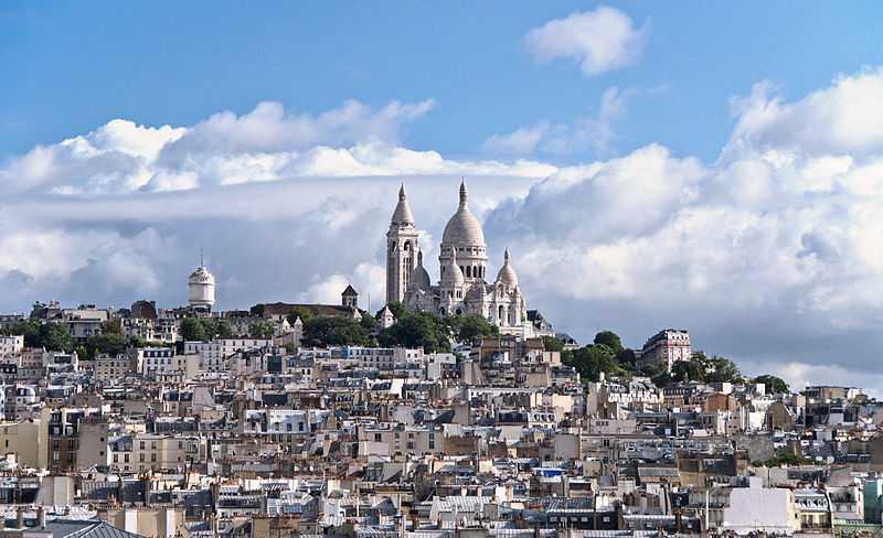 View above Montmartre and Basilique Sacré-Cœur from the top of Printemps Haussmann in Paris